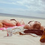 7 Summer Travel Destinations for Your July Vacation - girls sunbathing