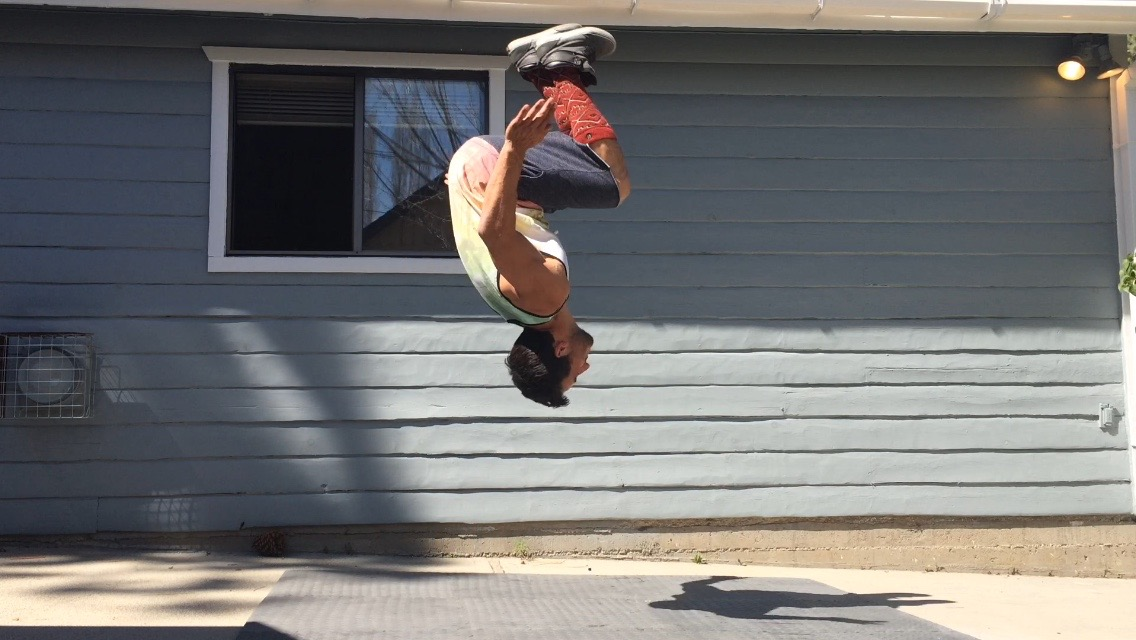 Shane Michael doing a backflip in front of a house in Big Bear California