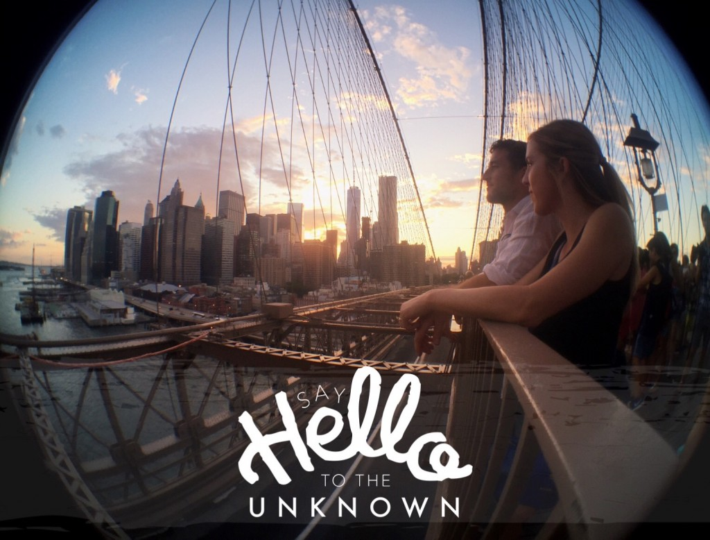 "Couple gazing at New York Skyline from the Brooklyn Bridge - text: Say hello to the unknown"" - girltripping.com"
