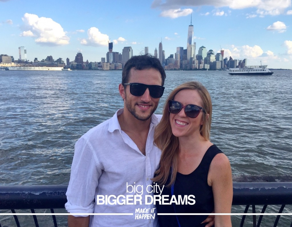 Melissa and Shane standing in front of New York skyline from across the Hudson - text: Big city, bigger dreams.